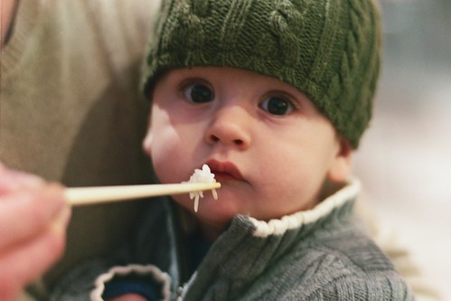 Baby eating rice