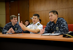 In this file photo, Capt. Fred Kacher, left, Republic of Singapore Navy Col. Seah Poh Yeen, and Capt. H.B. Le, right, discuss the sea phase of exercise Cooperation Afloat Readiness and Training (CARAT) Singapore in July. (U.S. Navy/MC1 Jay C. Pugh)