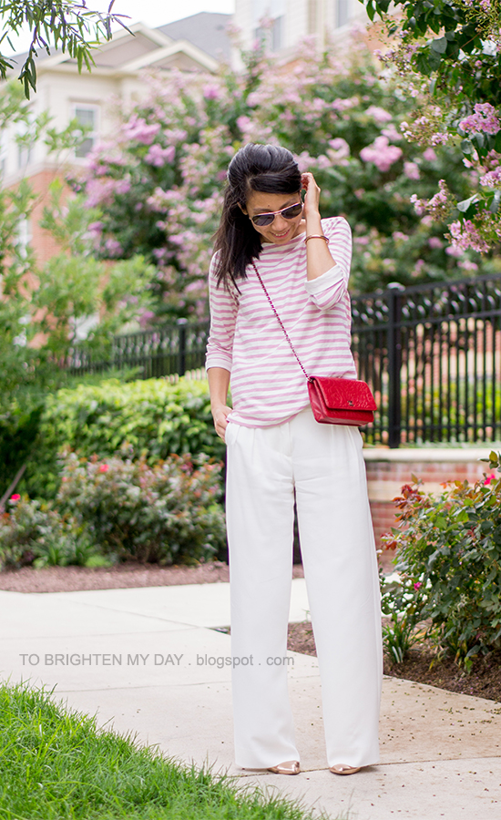 pink striped top, red crossbody bag, white wide legged pants
