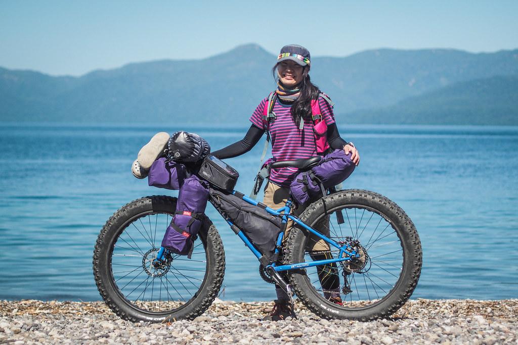 Kumiko and her awesome XS sized Surly Pugsley with self-made custom bike packs (Lake Shikotsu, Hokkaido, Japan)