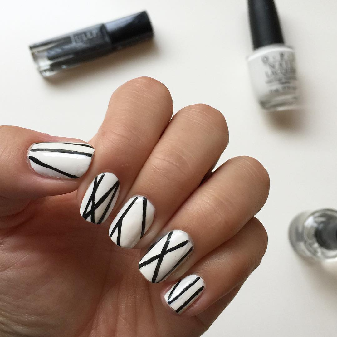 Black lines on white nails