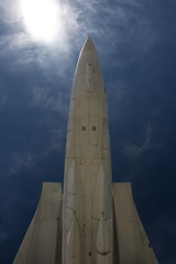 rocket(0.0), wing(0.0), spaceplane(0.0), tower(0.0), aviation(1.0), cloud(1.0), airplane(1.0), space shuttle(1.0), vehicle(1.0), blue(1.0), sky(1.0),