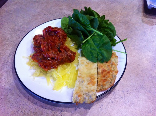 "Spaghetti squash, roasted marinara sauce, quinoa cheesy ""bread"", and spinach salad! Omnomnom."