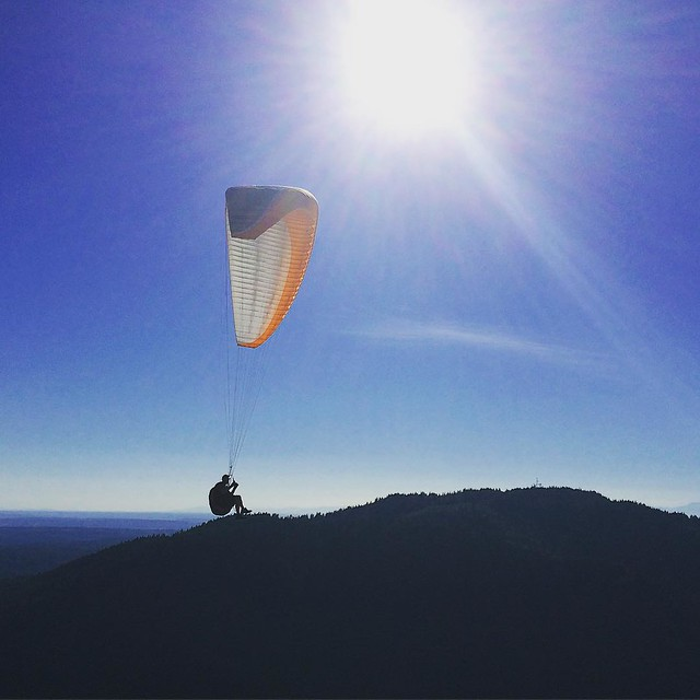 Mike flies. He's been paragliding at Tiger Mountain three times a week for the past 20 years!