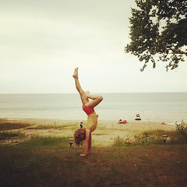Beach gymnastics, I'm in awe of her strength and determination! #KidsLife #MyFamily #CottageLife
