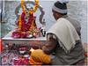 A pundit performing pooja