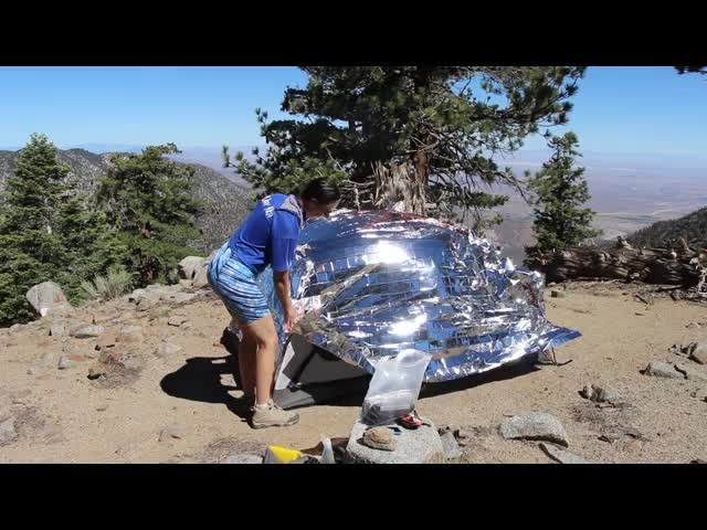 176 Video of the Mylar Emergency Blanket being added to our tent to block the sun