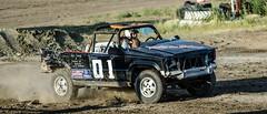 auto racing(0.0), compact sport utility vehicle(0.0), automobile(1.0), racing(1.0), vehicle(1.0), off road racing(1.0), off-roading(1.0), rally raid(1.0), jeep(1.0), off-road vehicle(1.0), mud(1.0), land vehicle(1.0),