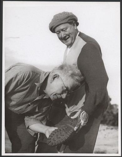 John Charles Thomas shows his American golf shoes to Mr George Sutherland of Melbourne, [1947?]