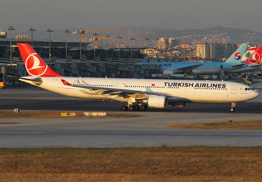 Passing the terminal on the way to RWY35L for departure to Dubai DXB during sunset. Delivered 12/2013.