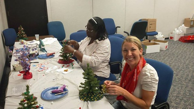 North Shore Bank employees help decorate.