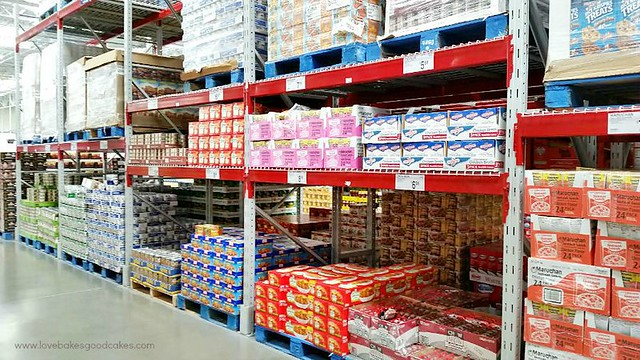A grocery store isle showing products on the shelves.