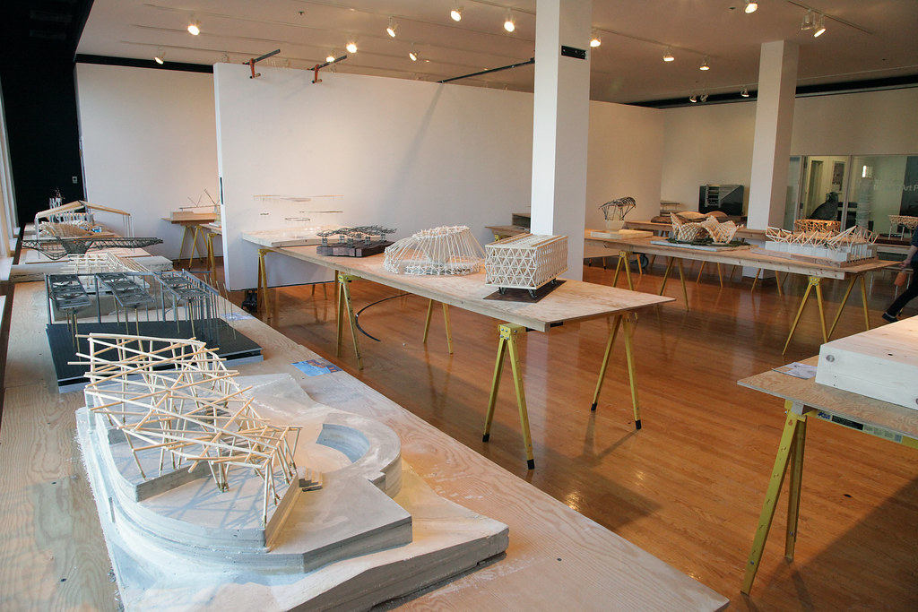 Students in the Structural Systems class working in Rand Hall and the Structural Systems exhibition in the John Hartell Gallery.