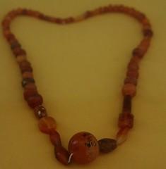 amber(0.0), buddhist prayer beads(0.0), bracelet(0.0), art(1.0), orange(1.0), jewelry making(1.0), jewellery(1.0), necklace(1.0), bead(1.0),
