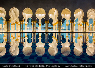 United Arab Emirates - Abu Dhabi - Sheikh Zayed Grand Mosque reflected in the pool at night