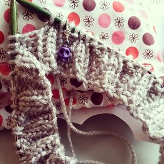 Knitting....so I don't kill people. :) #knitstagram #knittersofinstagram Love my purple skull #stitchmarker #getyourkniton #racetrackknitting #iknitsoidontkillpeople
