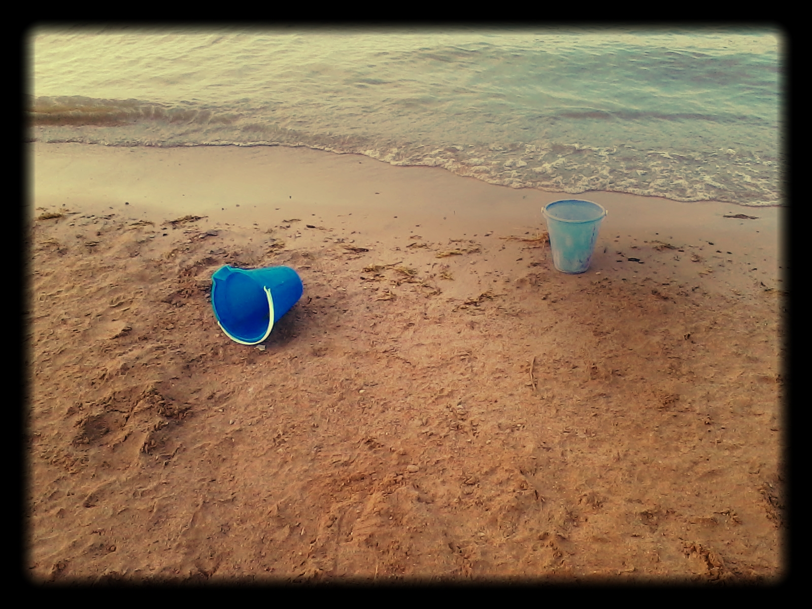 Buckets by the shore