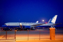 A rare 'blue moon' is seen at Andrews Air Force Base in Camp Springs, Maryland, on July 31, 2015, as it rises over the airplane that will carry U.S. Secretary of State John Kerry around the world to Egypt, Qatar, Singapore, Malaysia, and Vietnam over a span of eight days. [State Department photo/ Public Domain]