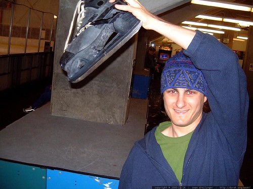 sean throwing his hockey skate into the trash   dscf1160
