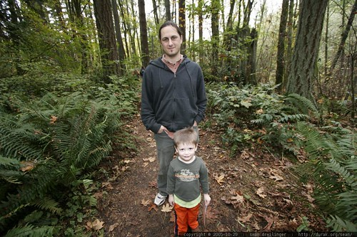 sean and nick standing amid ferns and fallen leaves in tryon creek state park