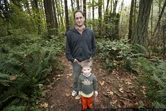sean and nick standing amid ferns and fallen leaves …