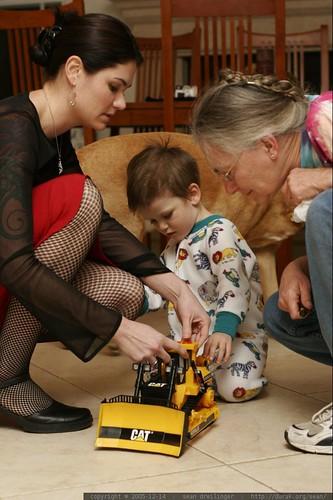 rachel and anna help nick enjoy his new bulldozer