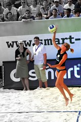 luxury vehicle(0.0), volleyball player(1.0), ball over a net games(1.0), volleyball(1.0), sports(1.0), ball game(1.0), beach volleyball(1.0),