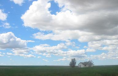 field sky clouds farmhouse