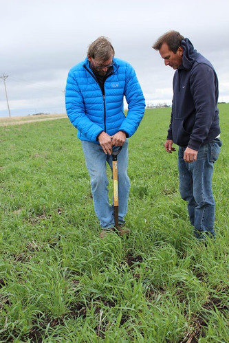 Brian Parkinson working with NRCS District Conservationist Joe Gates to make conservation improvements to his land