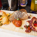 Sea platter - Grilled octopus, shrimp tempura, tuna tartar, sun dried tomatoes, jalapeno, capers, olive oil