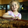 This is the face of a young lady who wants more rhubarb oat bars or even just a little more crumb topping.