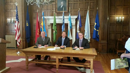 Signing an agreement supporting sage grouse conservation