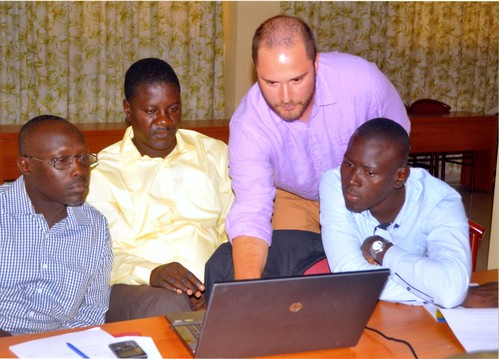 Jelliffe, third from left, works with Senegalese faculty members (left to right) Sadibou Sow,, Sacoura Diop and Ibrahima Ndiaye.