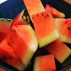About to enjoy some delicious watermelon grown in my parents' garden!