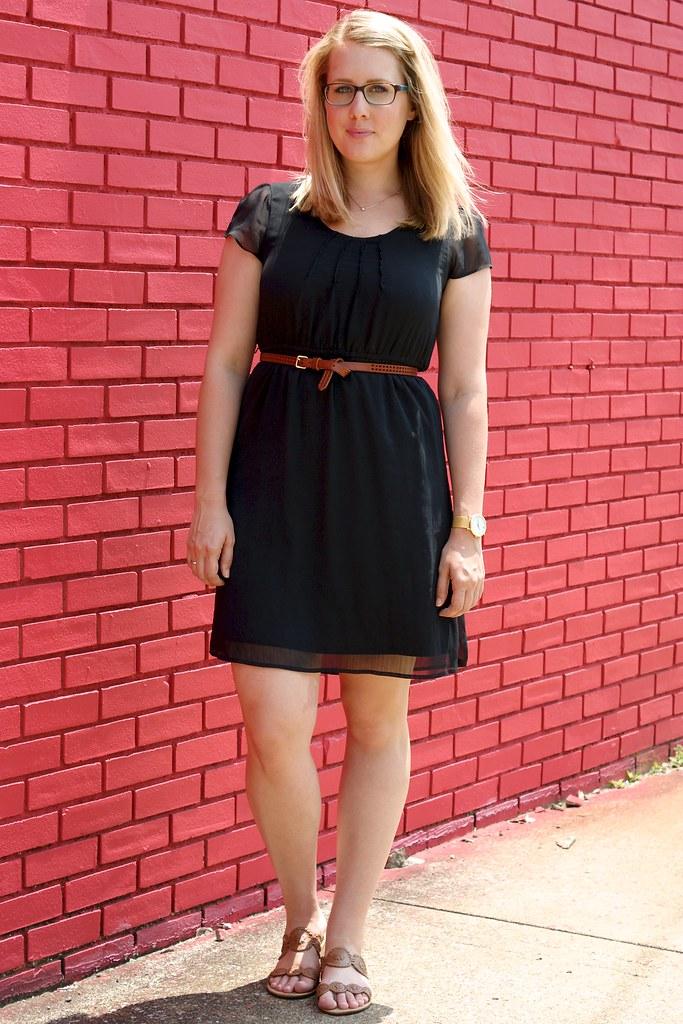 black dress with cognac accessories