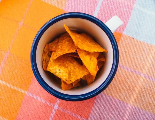 enamelware cup with doritos