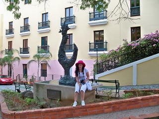 Puerto Rico (San Juan) A beautiful lady posing with one of the Jorge Zeno's animal sculptures