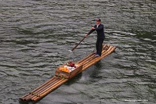 Local food seller on bamboo rafts - Li River Guangxi China