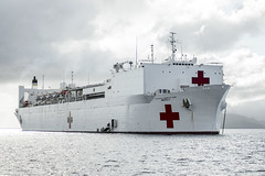 In this file photo, hospital ship USNS Mercy (T-AH 19) sits anchored off the coast of Fiji during the 2015 mission. (U.S. Navy/MC2 Mark El-Rayes)