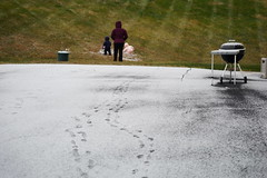 The twins make footprints in the snow