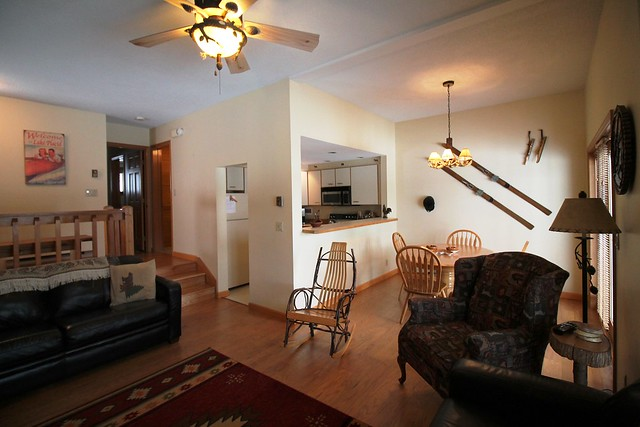 open floor plan with dining, living and kitchen all offering views of the lake and mountains;