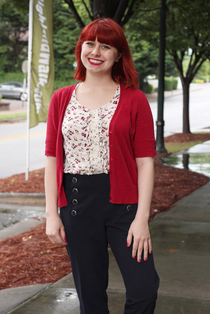 Red Short Sleeved Cardigan, Cream Colored Floral Top, and Blue Sailor Pants