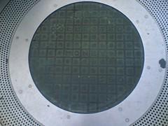 window(0.0), wheel(0.0), porthole(0.0), manhole cover(0.0), pattern(1.0), metal(1.0), manhole(1.0), circle(1.0),