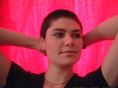 rachel in front of her new red curtains   dscf6586
