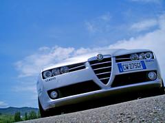 audi(0.0), automobile(1.0), automotive exterior(1.0), executive car(1.0), wheel(1.0), vehicle(1.0), automotive design(1.0), alfa romeo 159(1.0), bumper(1.0), land vehicle(1.0), luxury vehicle(1.0),