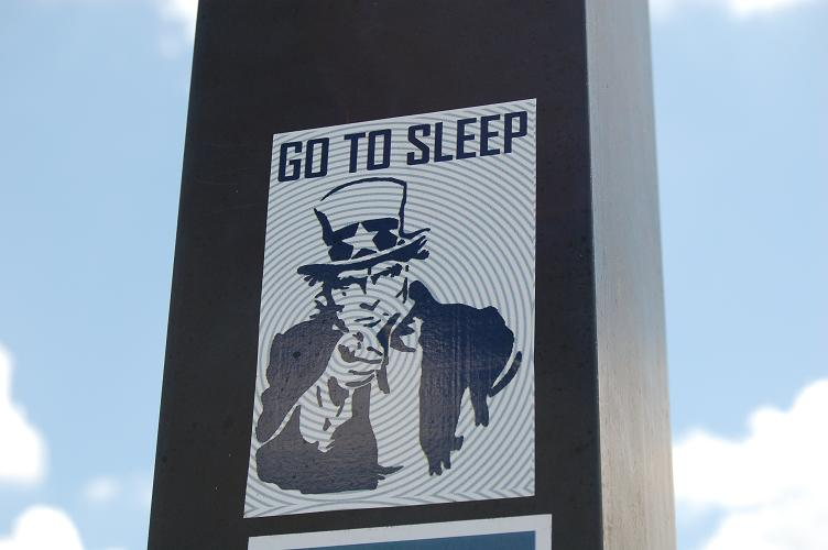 "Uncle Sam on a hypnotic background saying ""Go to Sleep."""