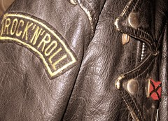 textile(0.0), brown(0.0), leather jacket(1.0), clothing(1.0), leather(1.0), outerwear(1.0), jacket(1.0),
