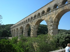 historic site(0.0), devil's bridge(1.0), ancient roman architecture(1.0), arch(1.0), ancient history(1.0), aqueduct(1.0), tourism(1.0), landmark(1.0), architecture(1.0), arch bridge(1.0), viaduct(1.0), bridge(1.0),