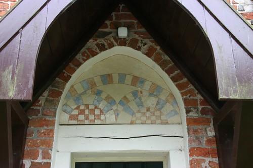 Schilderwerk boven de deur