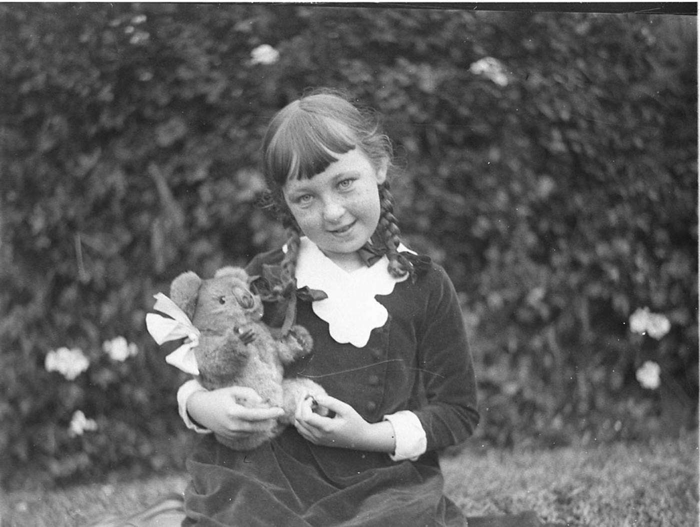 Mr Thatcher's little daughter holding toy koala, c. 1934 / by Sam Hood